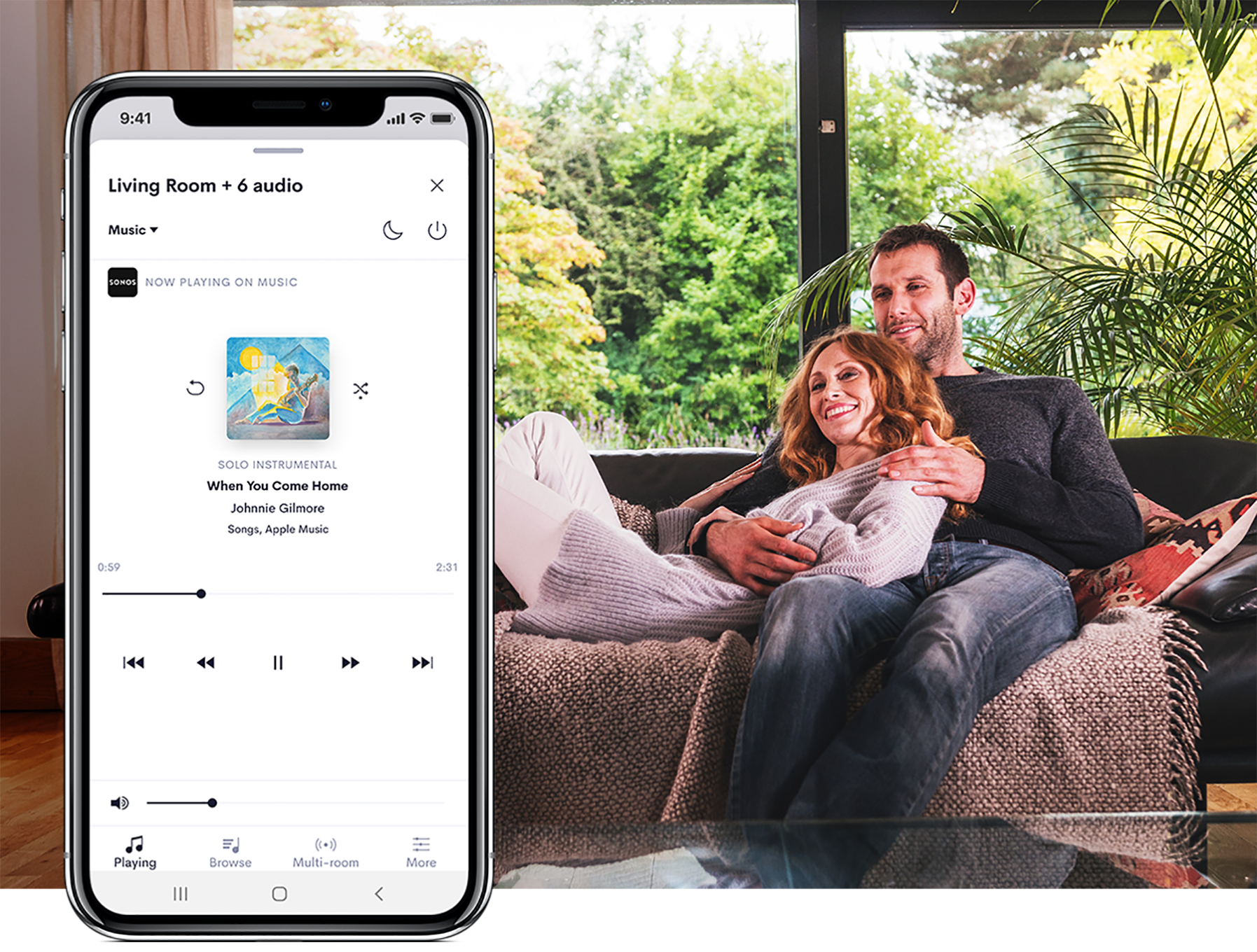 Couple in living room with image of smart phone with audio UI